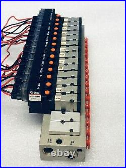SMC Manifold with 14 NVJ314M 24v Solenoid Valves and Cables. (Used)